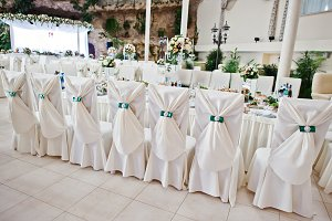 Elegant wedding chairs decorated wit