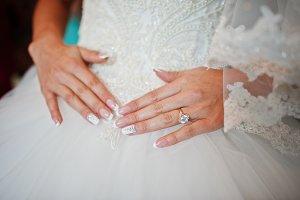 Fabulous bride holding her sophistic