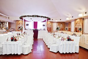 White chairs and tables of wedding q