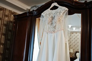 Amazing wedding dress on hangers at