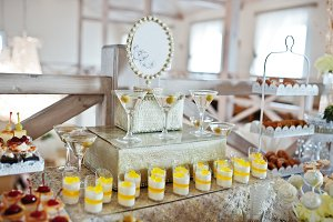Wedding cakes and candies with glass
