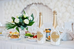 Golden champagne at wedding table of