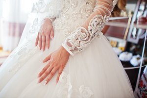 Hands of bride with glamour manicure