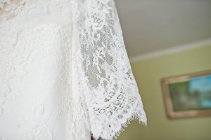 Bride's wedding dress hanging on the
