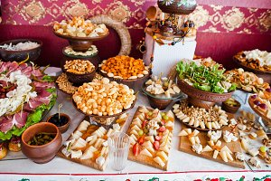 Cheese and meat decorated dishes on