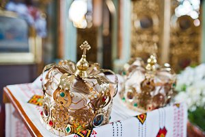 Close-up photo of wedding crowns in