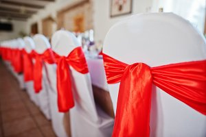 Gorgeously decorated chairs with red
