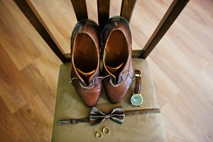 Groom's shoes, bow tie, rings and a