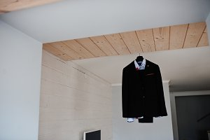 Groom's wedding suit hanging on the