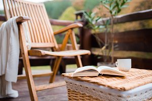 A wooden chair and a book on a
