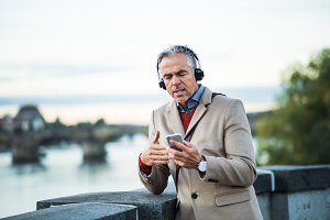 Mature businessman with headphones