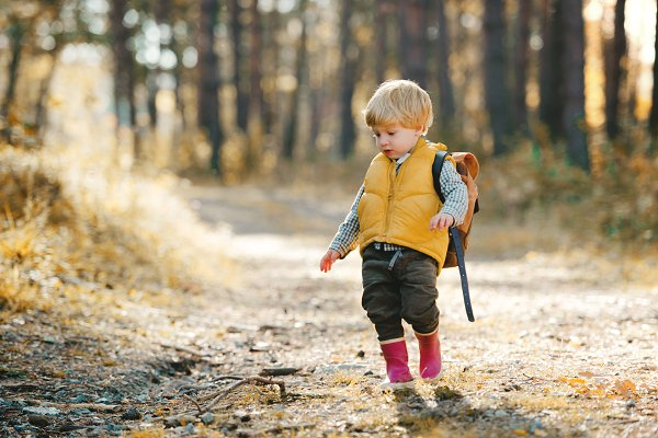 People Stock Photos: HalfPoint - A toddler son with backpack standing
