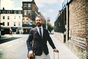 Hipster businessman with suitcase