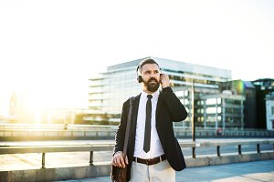 Hipster businessman with hadphones