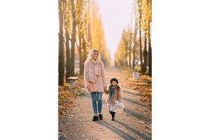 mother and daughter walking in
