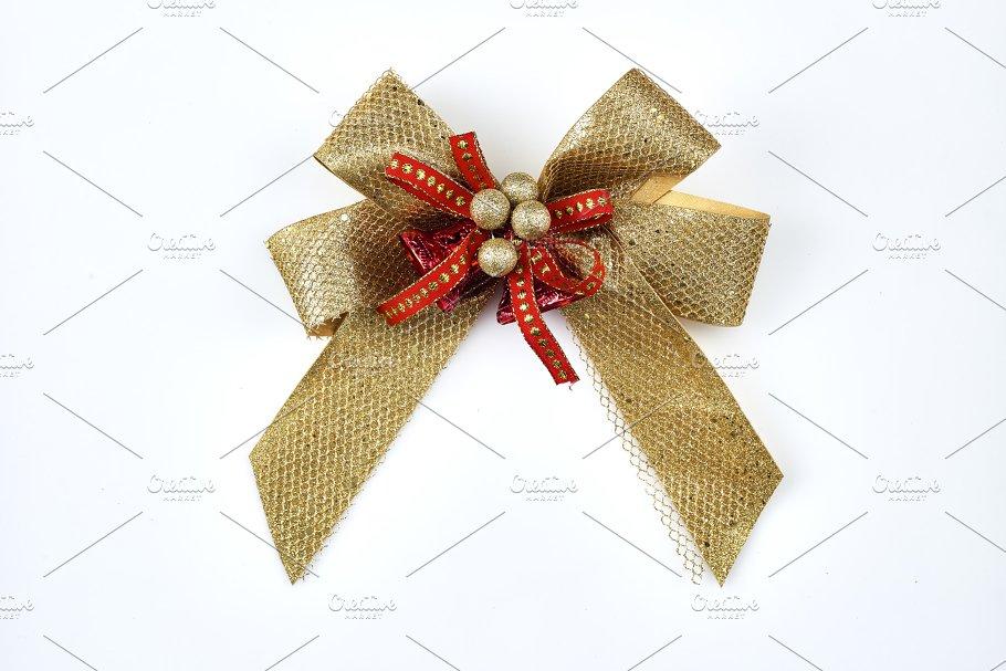 gold gift bow isolated on white holiday photos creative market