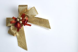 gold gift bow isolated on white