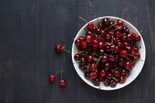 Bowl full of fresh cherries.