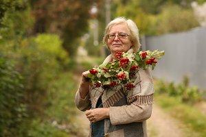 healthy pensioner woman in garden wa
