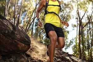 Male runner running on rock