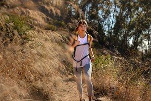 Fit woman running through mountain