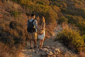Hiker couple walking through