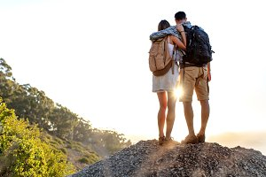 Hiking couple standing on a rock