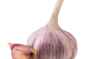 Garlic head and slice close-up on a