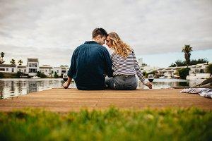 Couple sitting near a lake