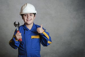 smiling child with a white helmet