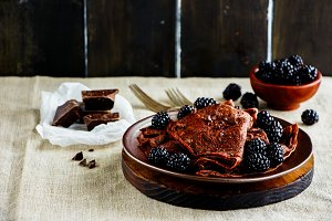 Chocolate crepes with blackberrie