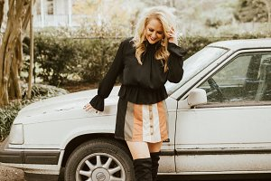 Model Smiling And Leaning On Car