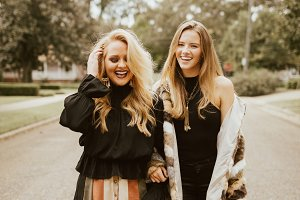 Models Smiling In Fall Wear