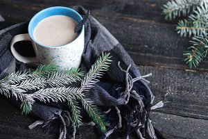 Mug with hot cocoa in a scarf with t