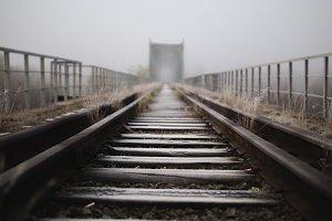 old railway bridge in the early fogg