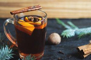 Hot winter drink mulled wine on dark