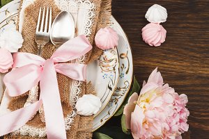 Tableware with light pink peonies an