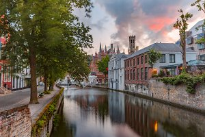 Green canal in Bruges, Belgium Tower
