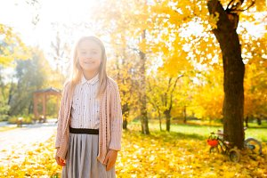 Photo of girl in autumn forest in