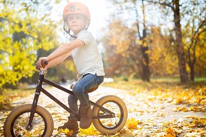 Photo of boy in helmet on running