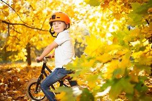 Image of boy in red helmet on