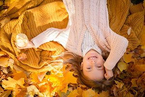 Photo of girl lying in autumn forest