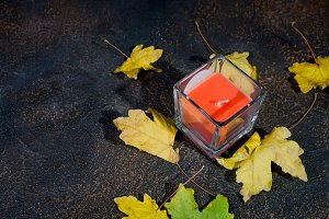 autumn leaves, chestnuts, candles on