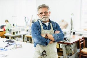 serious mature male craftsman in apr