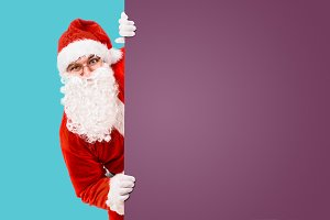 Santa Claus with colorful advertisem