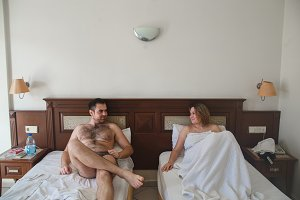 Happy young couple relaxing in hotel