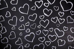 hearts background on blackboard