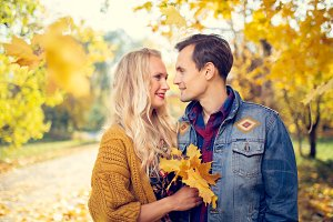 Photo of couple in love at autumn