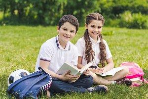 smiling schoolchildren doing homewor
