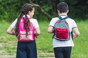 rear view of adorable schoolchildren